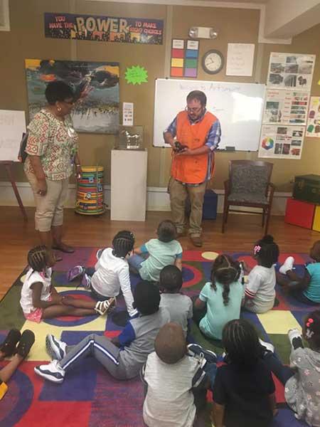 Children watching a presentation in class